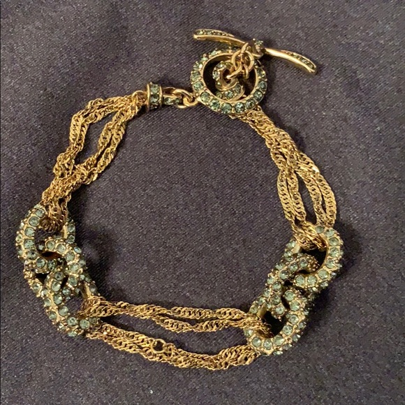 Monet gold tone bracelet with green crystals